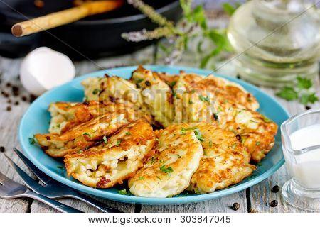 Pan Fried Zucchini Pancakes Stuffed With Meat