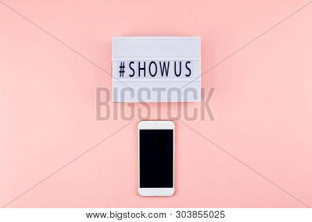 Creative Top View Flat Lay Of Lightbox With Hashtag Show Us Message And Mobile Phone Mockup Pink Bac