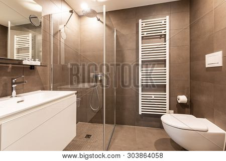 Modern bathroom with marble tiles, nobody inside