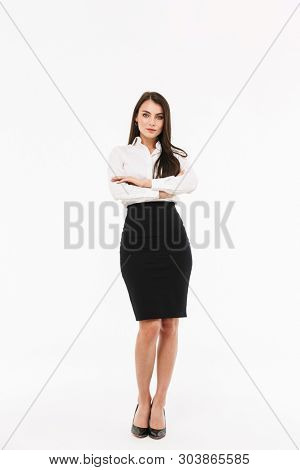Photo of modern female worker businesswoman dressed in formal wear looking at camera while working in office isolated over white background