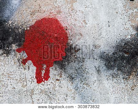 Red stain from the spray on the wall
