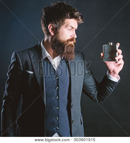 Man Bearded Hipster Wear Elegant Suit Hold Metal Flask For Alcohol. Alcohol Drink. Have Alcohol Drin