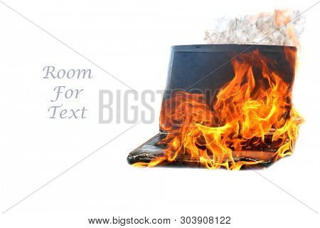 Computer Fire. A laptop computer engulfed in flames of hot fire. Smoke and Fire burn and melt a computer.  Computer damage or data destruction concepts. Isolated on white. Room for text.