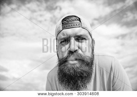 Smoking Helps Him Relax. Bearded Man Smoking Outdoor. Smoking Addict With Long Beard And Mustache. B