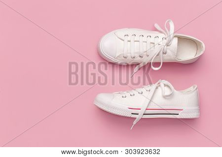 White Female Fashion Sneakers On Pink Background. Flat Lay, Top View, Copy Space. Womens Shoes. Styl