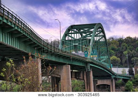 The Fort Henry Bridge spans the Ohio river from Ohio into Wheeling West Virginia.  This is an historic landmark bridge and popular travel destination.