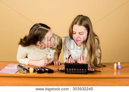 Experts In Colour. Adorable Small Makeup Artists Using Colour Cosmetics. Cute Little Girls Applying