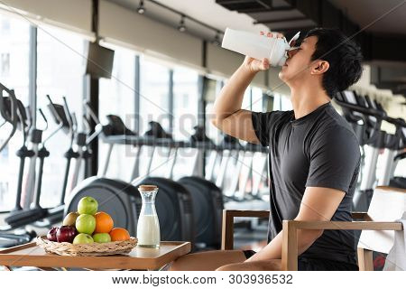 Handsome Man Drinking Protein Shake Milk And Many Kind Of Fruits For Nourishing Body Daily. People L
