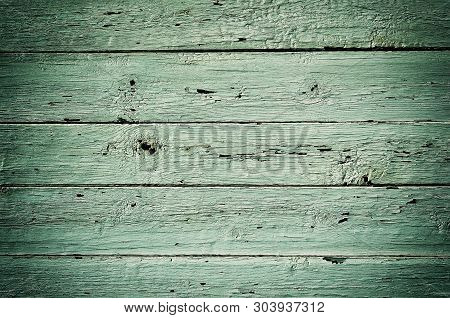 Obsolete weathered green painted wooden planks background poster