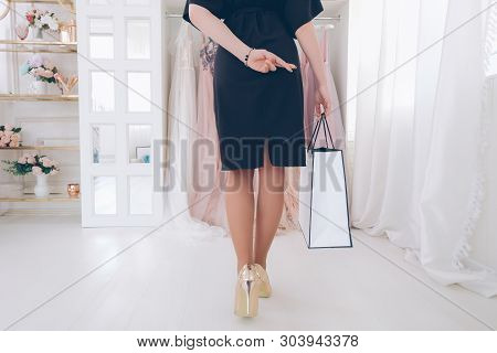 Trendsetter Lifestyle. Cropped Shot, Back View Of Woman Walking To Boutique With Fingers Crossed, Go