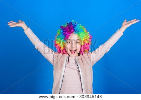 Happiness Only Real When Shared. Happy Little Girl Child Wearing Bright Wig Hair Smiling With Happin