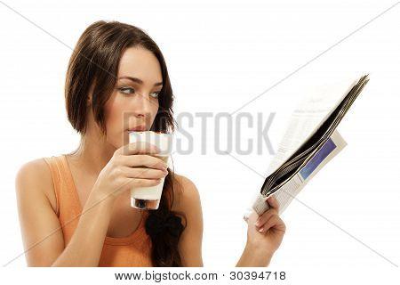 beautiful woman drinking latte macchiato coffee reading newspaper