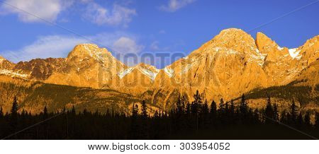 Canadian rocky mountains with golden sun light