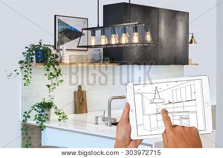 Hands Holding Tablet Showing Kitchen Plans In Finished Room. Modern Apartment. Kitchen Drawing. Home