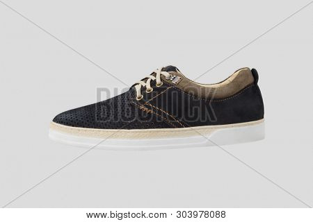 pair of fashionable leather sneakers with laces isolated on white