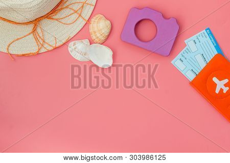 Camera, Hat, Passport And Tickets For Summer Photo At The Seaside On Pink Background Top View Mock U
