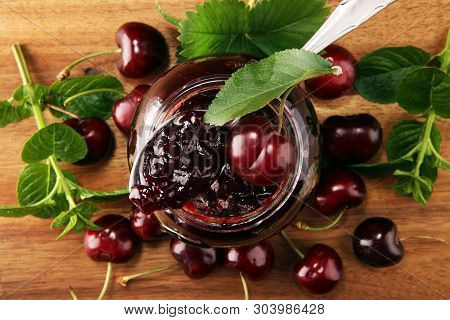 Rustic Jar With Cherry Jam And Fresh Cherries, Homemade Preserves On Wood