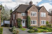 Semi-detached house and garden in Pinner, an affluent London suburb poster