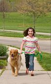 Girl Walking Down the Sidewalk With Dog poster