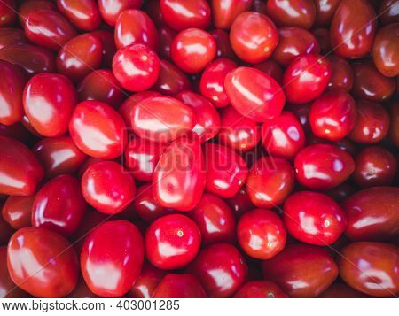 Red Tomatoes. Red Tomato Background. A Bunch Of Fresh Tomatoes. Vertical Image.