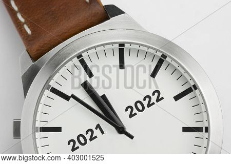 Macro Photo Of A Modern Metal Watch With The Text Two Thousand And Twenty One And Two Thousand And T