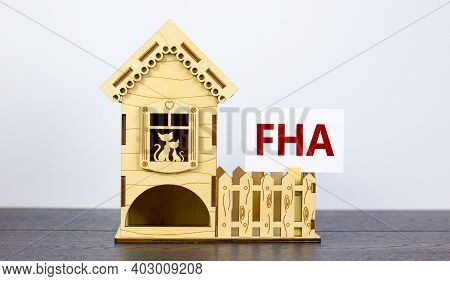 Fha, Federal Housing Administration Symbol. White Paper With Word 'fha, Federal Housing Administrati