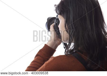 Side View Of A Female Photographer Holding A Camera Isolated On A White Background For Composites.