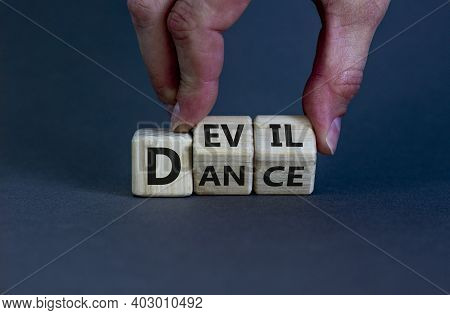 Dance With The Devil Symbol. Hand Turns Cubes And Changes The Word 'dance' To 'devil'. Beautiful Gre