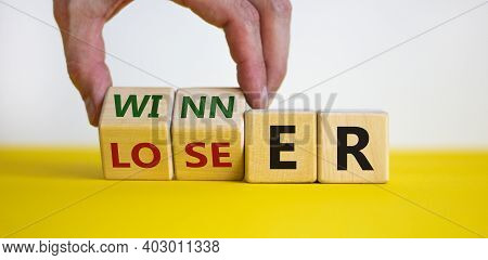 Loser Or Winner Symbol. Businessman Hand Turns Cubes And Changes The Word 'loser' To 'winner'. Beaut