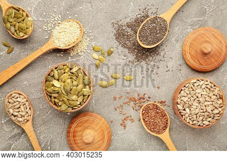 Healthy Superfood: Sesame, Pumpkin Seeds, Sunflower Seeds, Flax Seeds And Chia On Grey Background. T
