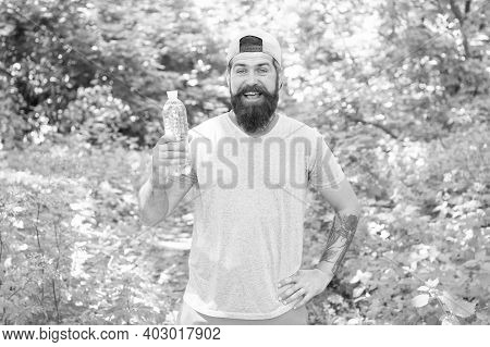 Staying Hydrated Is Must. Fitness Portrait Of Bearded Man. Mature Guy In Hat. Thirsty Hipster Travel