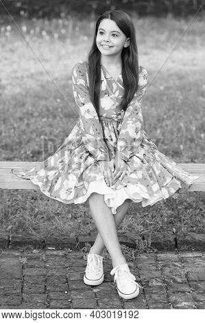 Summer Look Inspiration. Happy Kid Sit On Park Bench. Beauty Look Of Cute Girl. Fashion Look Of Litt