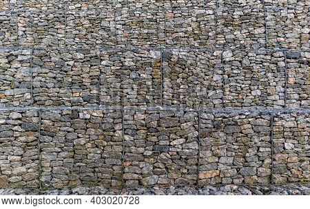 Metal Cages Filled With Rocks. Gabions Protective Wall Filled With Stones And Tied With Thick Metal