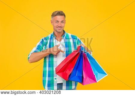 Nice Purchase. Purchase In Paper Bags. Guy Hold Gift. Holiday Flash Sale And Special Offer. Cyber Mo