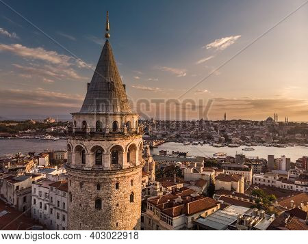 Aerial Evening Shot Of The Galata Tower In Istanbul, Turkey. Aerial View Of Landmark At Golden Hour