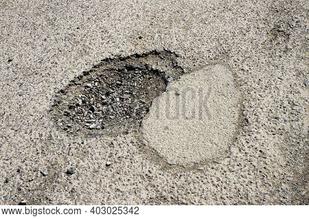 Detailed View On Pothole On The Road