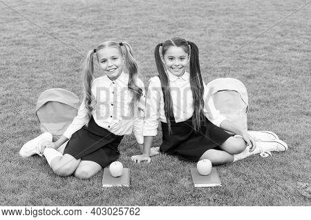 Better Ingredients Better Diet. Happy Girls Sit On Green Grass. School Break. Snack Break. Vegetaria