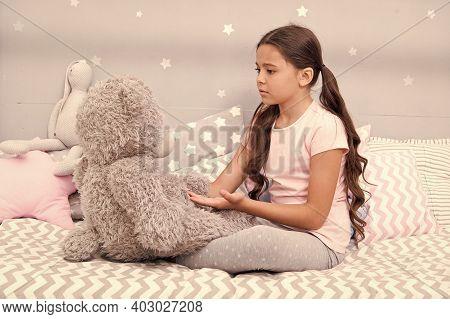 Communication. Favorite Toy. Girl Child Hug Teddy Bear In Her Bedroom. Pleasant Time In Cozy Bedroom