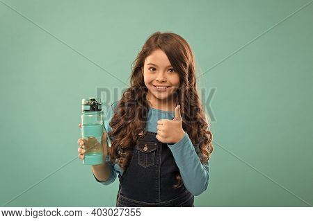 Best For Your Health. Small Girl Hold Bottle. Detox And People. Healthy Drink For Teen Child. Drink