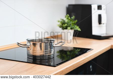 Pot In The Kitchen On The Induction Hob. Induction Electrical Stove