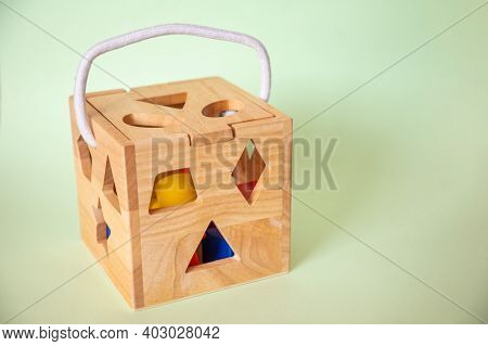 Cute Wooden Handmade Toys For Kids On Green Background. Ecological Toys Concept