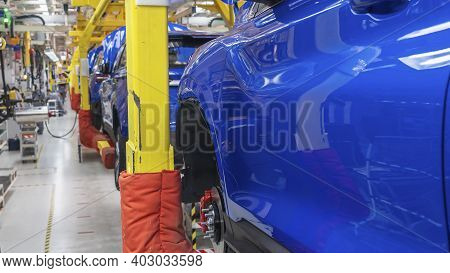 Assembling Cars On Conveyor Line. Production Line For Manufacturing Of The Car Body In The Car Facto