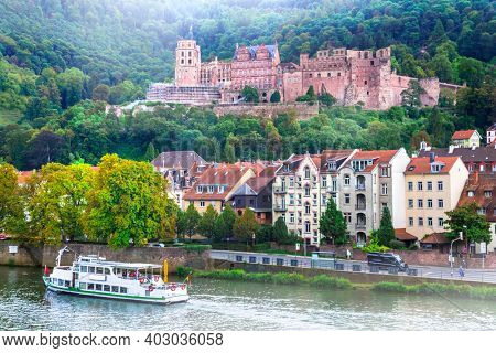 Landmarks and beautiful towns of Germany - medieval  Heidelberg, view with castle and river boat