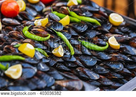 Turkish Style Appetizer Street Food Stuffed Mussels Called Midye Dolma On Bench For Sale With Lemon