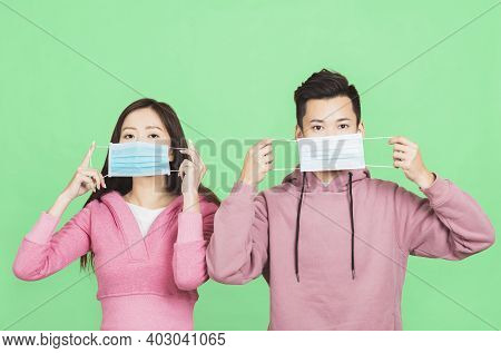 Young Couple Wearing  Protective Face Mask . Flu And Coronavirus Prevention  Concept