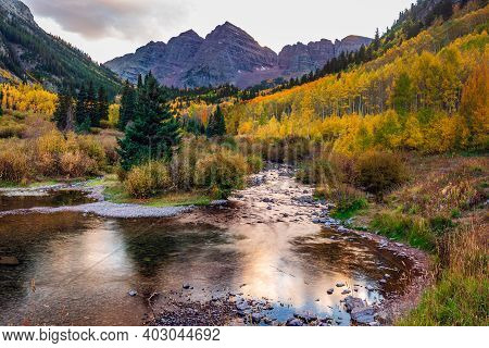 Autumn Aspen Trees Reflected In The Lake. Maroon Bells At Autumn Season In In Aspen Colorado, Usa.