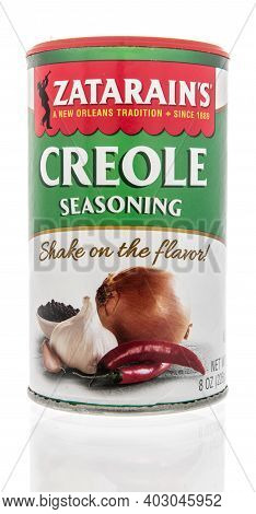 Winneconne, Wi -9 January 2021: A Package Of Package Of Zatarains Creole Seasoning On An Isolated Ba