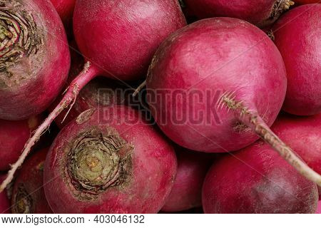 Pile Of Red Turnips As Background, Closeup