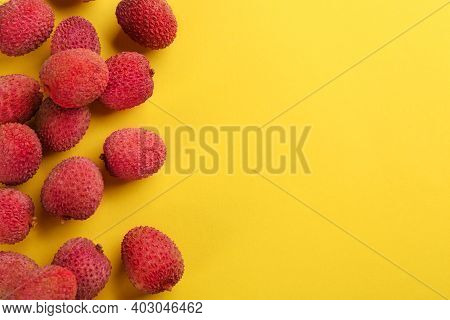 Fresh Ripe Lychees On Yellow Background, Flat Lay. Space For Text