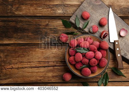 Fresh Ripe Lychee Fruits And Knife On Wooden Table, Flat Lay. Space For Text